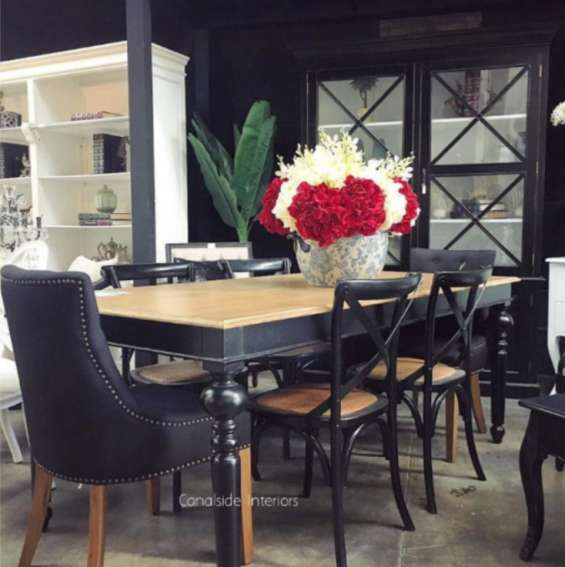 The chandon dining table has beautiful handcrafted legs and a stunning top. the perfect balance between tradition, sophistication, elegance and simplicity, creating the perfect dining space. a stunning addition to any decor! distressed black with limewash